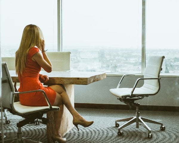 Women in conference room on phone